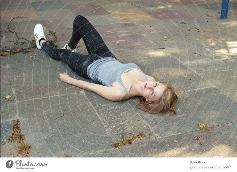 Portrait of a young woman lying on the floor and looking up into the camera Woman Young woman Slim already athletic Blonde youthful 18-25 years red blonde hair