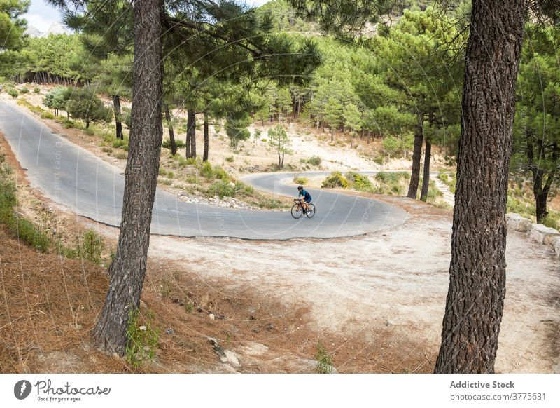 Female cyclist in helmet practicing on road horizontal woman young adult road bike mature woman driving 40 years motion riding sport athlete athleticism