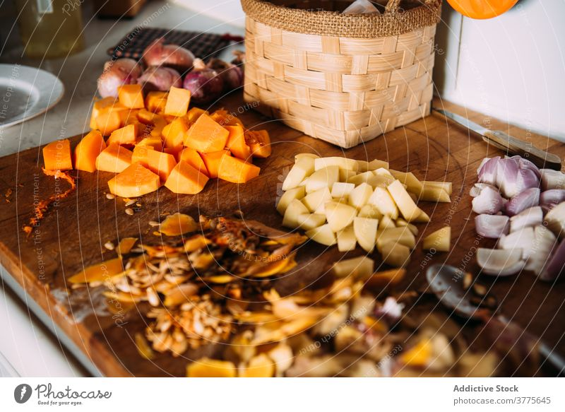 Chopped ingredients for cream soup recipe on table vegetable cook chop cut various pumpkin potato food onion assorted fresh kitchen prepare cuisine culinary