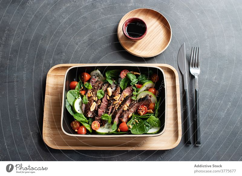 Beef thai salad served on dish mixed soy starter culture eastern roast cooking lunch beef salad top tomato asian cuisine vietnamese meat salad food meal