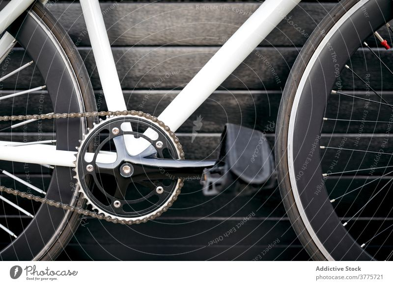 Cropped modern bicycle bike vehicle city street urban trendy transport town design inspiration pavement building ride contemporary outdoors horizontal crop wall