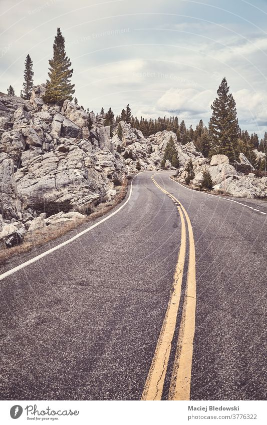 Road in Yellowstone National Park, Wyoming, USA. road travel nature sky trip journey mountains landscape scenic scenery cloud national park weather no people