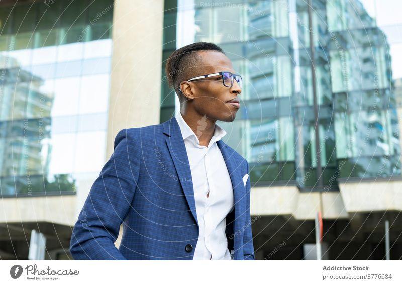 Handsome black businessman in downtown well dressed gentleman entrepreneur city suit respectable handsome male ethnic african american elegant formal