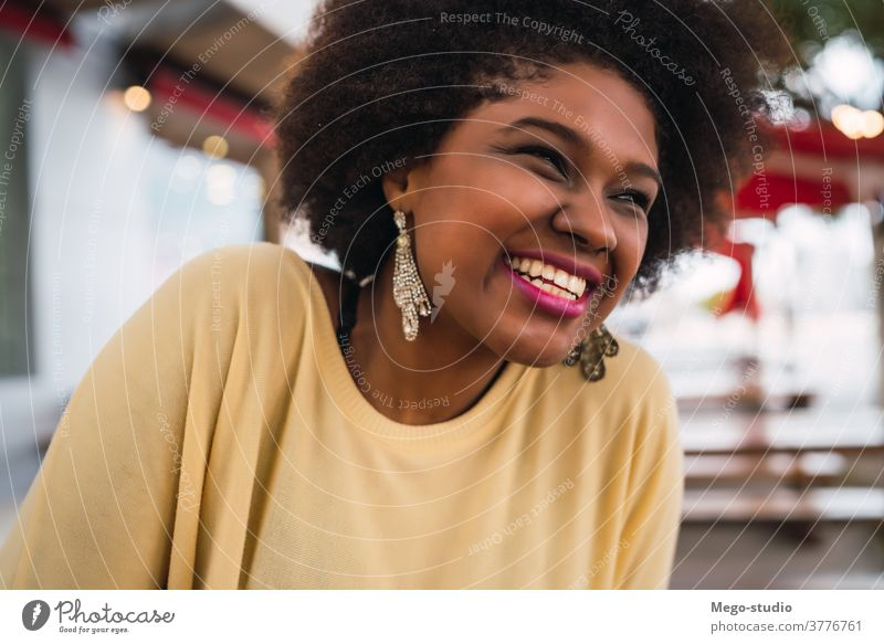 Afro american latin woman smiling. coffee shop brazilian beautiful outdoors cafe brunette curly hair time off customer confident frizzy hair leisure free time