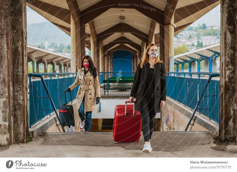 woman traveling with luggage bag and face mask architecture background beautiful building city color colorful coronavirus covid-19 culture destination europe