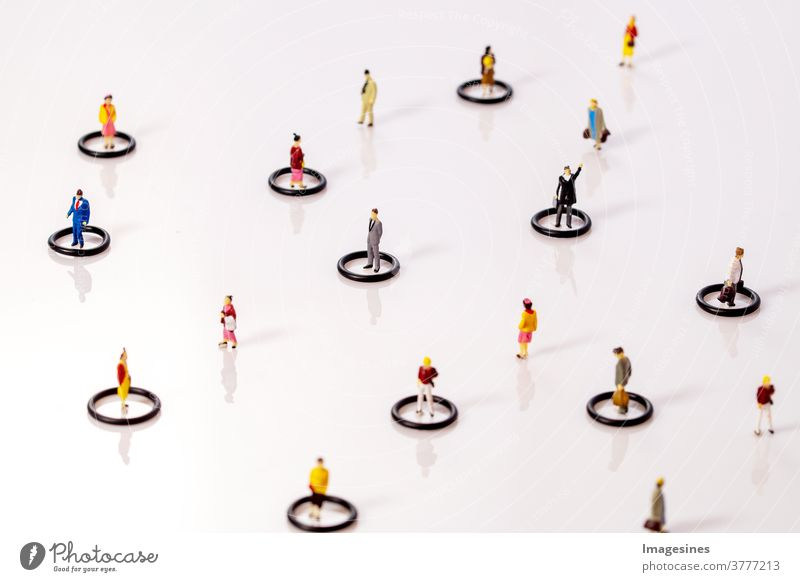 Social dissociation. Miniature toy people in circles keeping distance in public social problems Dissociation covid-19 Teamwork Concepts reduction coronavirus