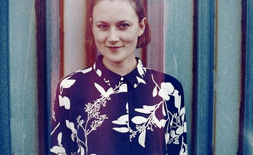 analogue, cropped portrait with false colours of a young woman in front of a rusty trapezoidal sheet metal wall Woman Young woman already Slim Blouse
