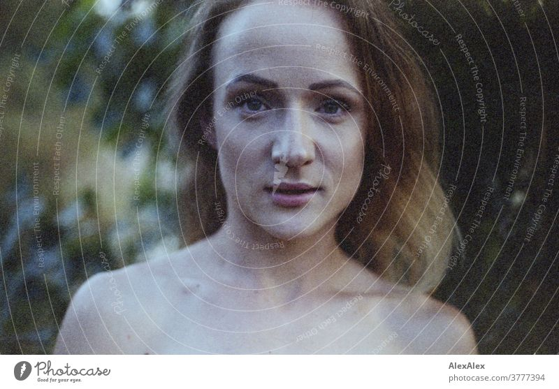 analogue, direct, close portrait of a young woman in front of a bush Woman already Near fit daintily Skin Naked Face Shoulders décolleté Blonde