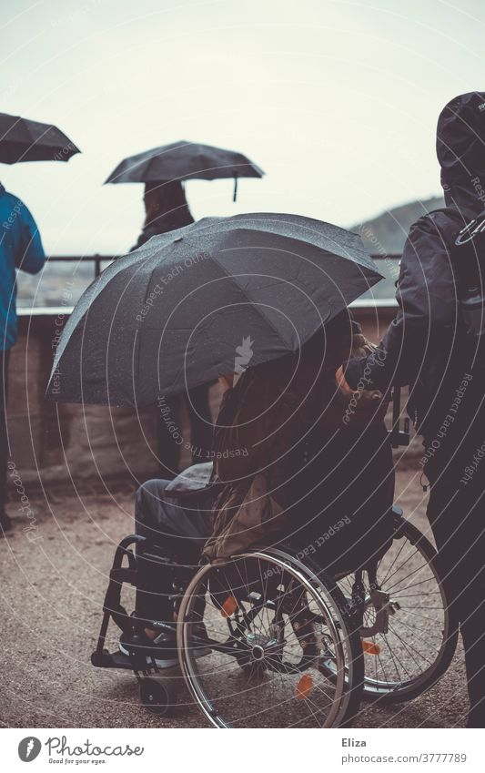 Trip with wheelchair and umbrella because it is raining and the weather is bad. Wheelchair Rain Umbrella Weather barrier-free Vantage point Sightseeing Autumn