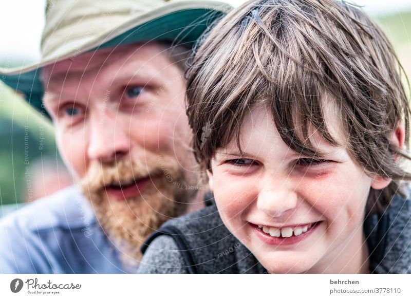 love.live.laugh Smiling Affection proximity Cuddling portrait Light Day Love Son Colour photo Warm-heartedness Together Safety (feeling of) Trust Facial hair