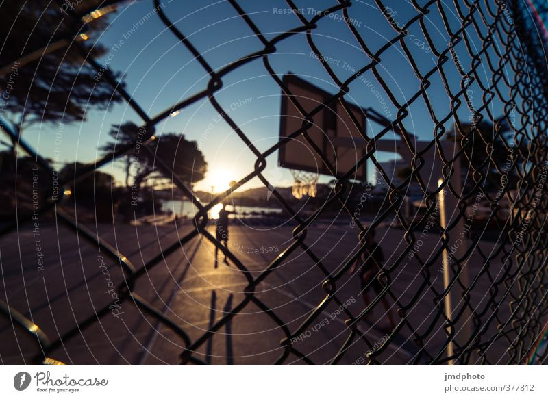 behind the fence Leisure and hobbies Summer Summer vacation Sun Ocean Sports Fitness Sports Training Sportsperson Ball Human being Masculine Boy (child)