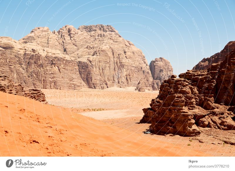 in the desert  sand and mountain adventure destination rum wadi jordan landscape nature valley sky red east rock middle tourism dry natural travel background