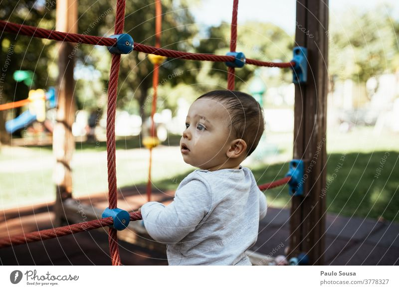 Toddler playing in the playground Playing Playground Park Kindergarten 1 - 3 years Leisure and hobbies Human being Colour photo Joy Child Exterior shot Day