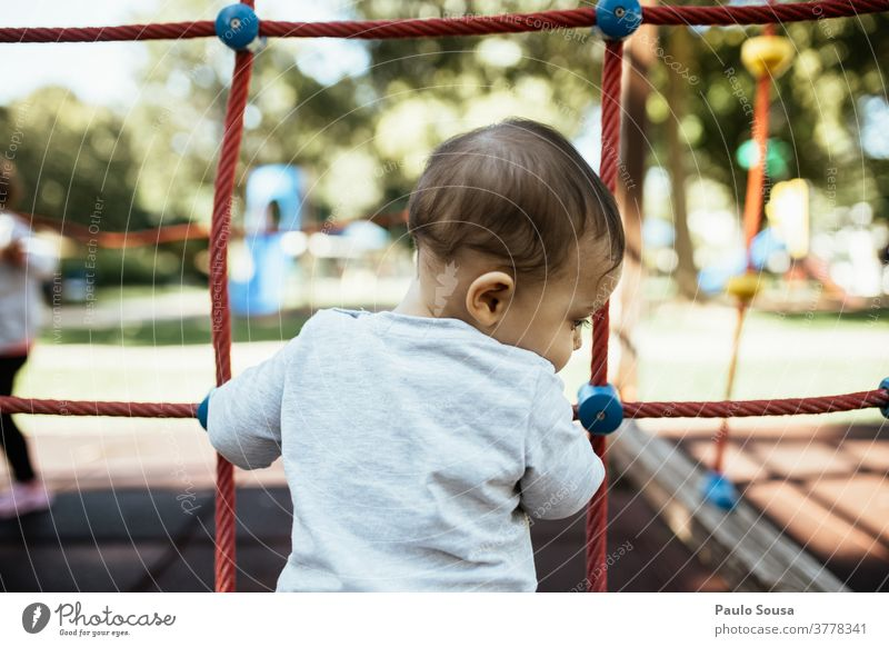 Rear view child playing in the playground Kindergarten Playground Toddler childhood Child Children's game Parenting 1 - 3 years Human being Leisure and hobbies