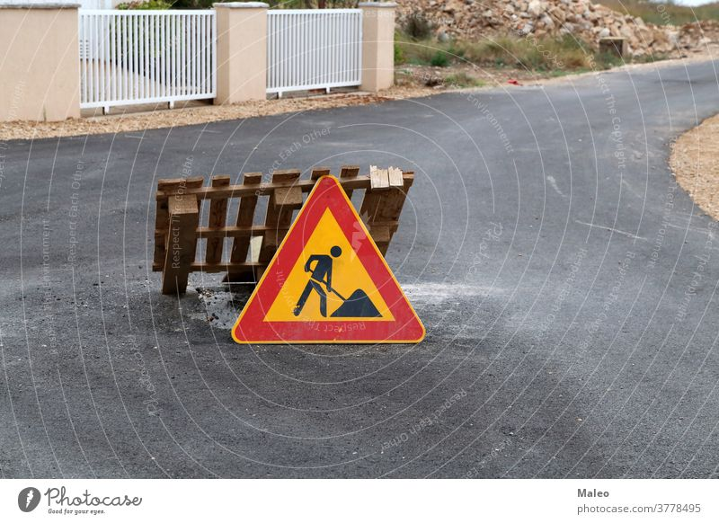 Road sign pending reconstruction of a road repair warning traffic symbol indication attention caution illustration notice street danger safety signal isolated