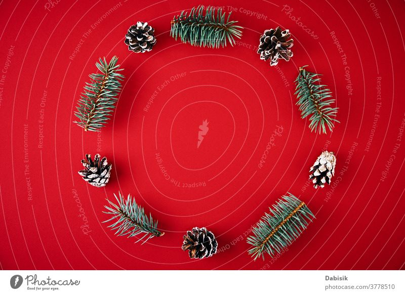 Christmas composition. Wreath made of fir tree branches and festive pine cones on a red background, top view christmas decoration wreath holiday new year xmas