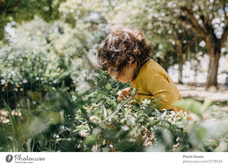 Child playing in the garden Children's game childhood Garden Playing 1 - 3 years Caucasian colorful Infancy Happiness Leisure and hobbies Colour photo