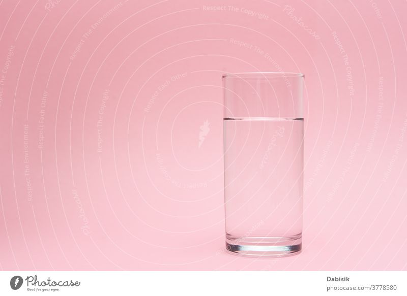 Glass of water on a pink background drink glass pure pour shadow concept liquid beverage clean healthy fresh freshness transparent white clear natural aqua