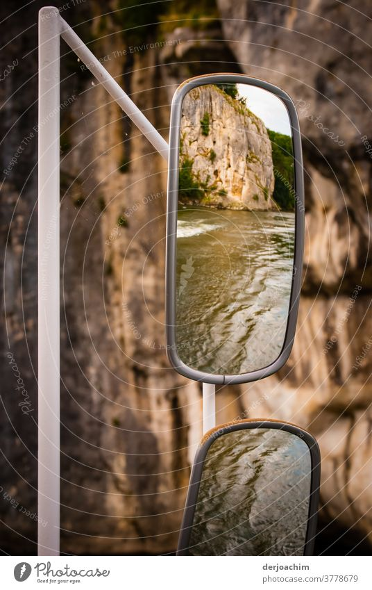 Rear-view mirror on a ship, at the Danube narrows near Weltenburg. You can see water and rocks. Rear view mirror Driving Colour photo Vacation & Travel