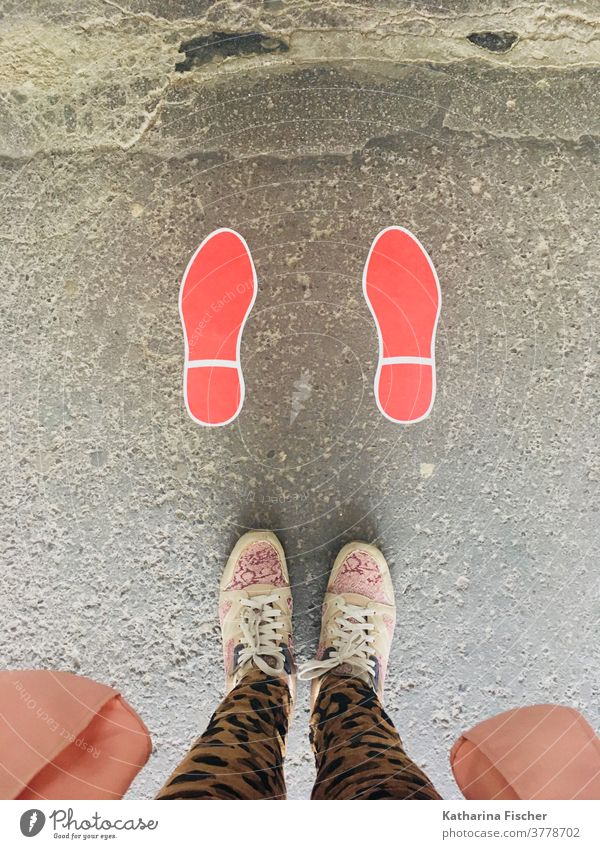 Steps on the road in red Bird's-eye view Footwear Exterior shot Day feet Legs Pants Colour photo Floor covering sneakers Red Footprint; Stand Street Brown Gray