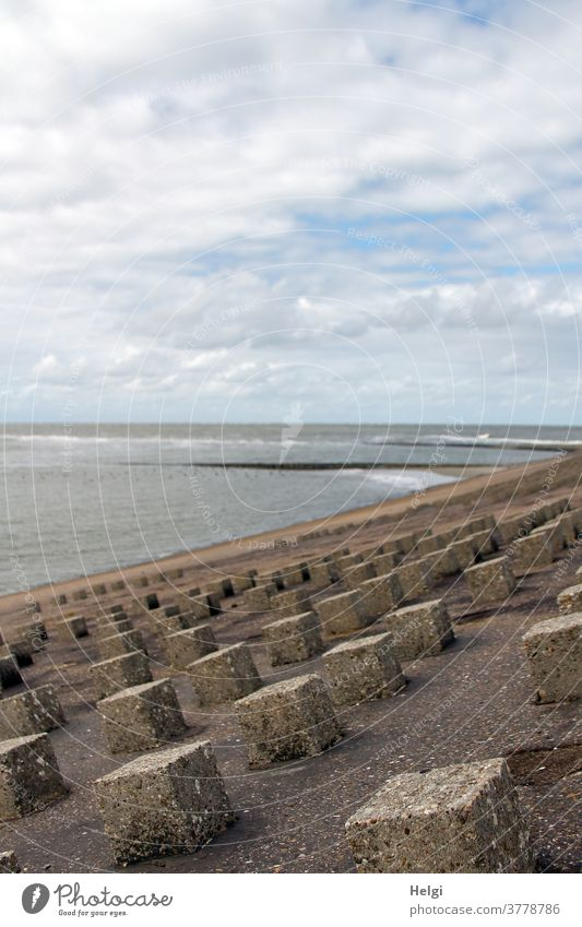 Küstenschutz - Concrete blocks as breakwaters at the dike of Wangerooge, in the background the North Sea coastal protection Dike dyke protection Water Polder