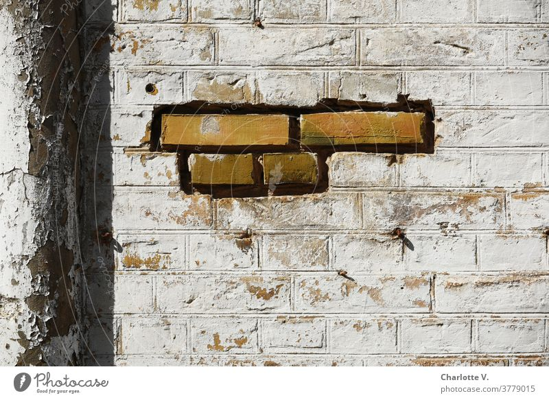 Patchwork | repaired wall Wall (barrier) bricks masonry Rain gutter Flake off flaking flaking paint Building stone patchwork Wall (building) Old Exterior shot