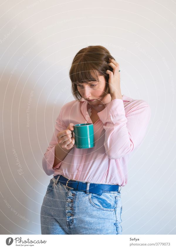 Young sad woman drinking coffee and thinking young depression stress stressed feeling worried psychology mental unhappy lonely pink serious thoughtful depressed