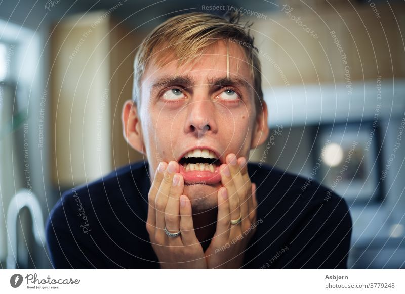 Man stressed and frustrated surprised confused fearful expression why? thinking future Human being Emotions Funny Portrait photograph Face Stress Problem