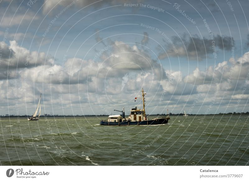 Fishing cutter and sailing yacht on the IJsselmeer in windy weather Nature Water Waves fishing cutter Navigation Ocean Horizon Clouds Sky Vacation & Travel