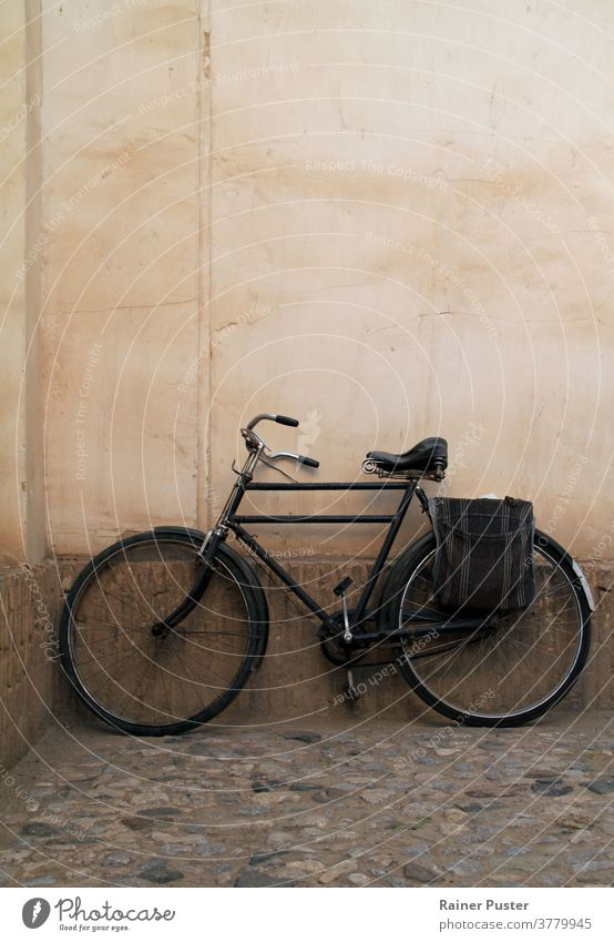 Vintage bike leaning against a wall antique background bicycle classic old outdoor retro road street style town transport transportation urban vintage wheel