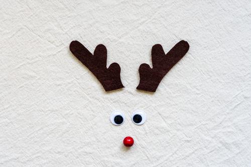A homemade reindeer antler made of felt with wobbly eyes and red nose reindeer antlers Felt Self-made Brown Nose Red Christmas & Advent Humor Funny Colour photo