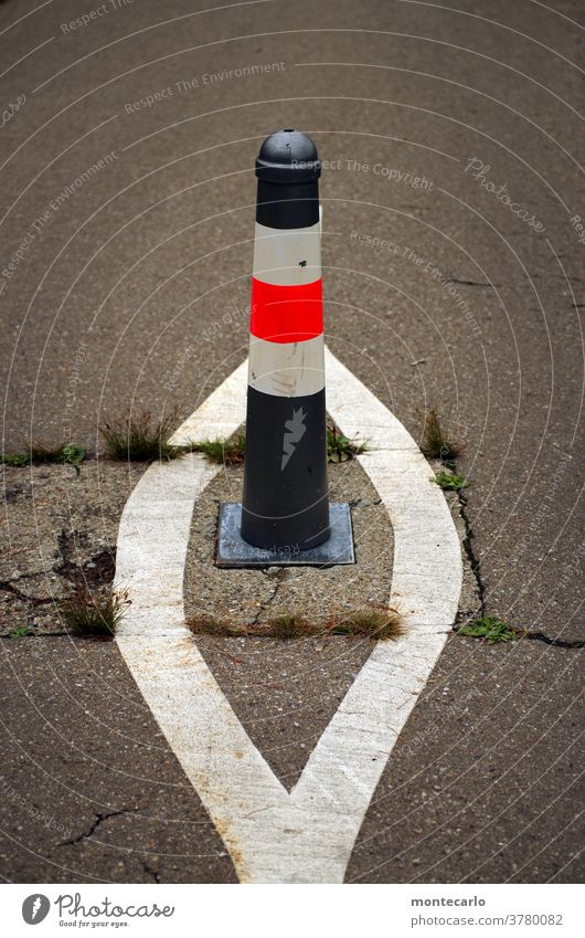 Bollard on a bicycle path with extra markings Asphalt gap bicycle lane Risk of accident accident cover Traffic regulation traffic control Street trace Transport