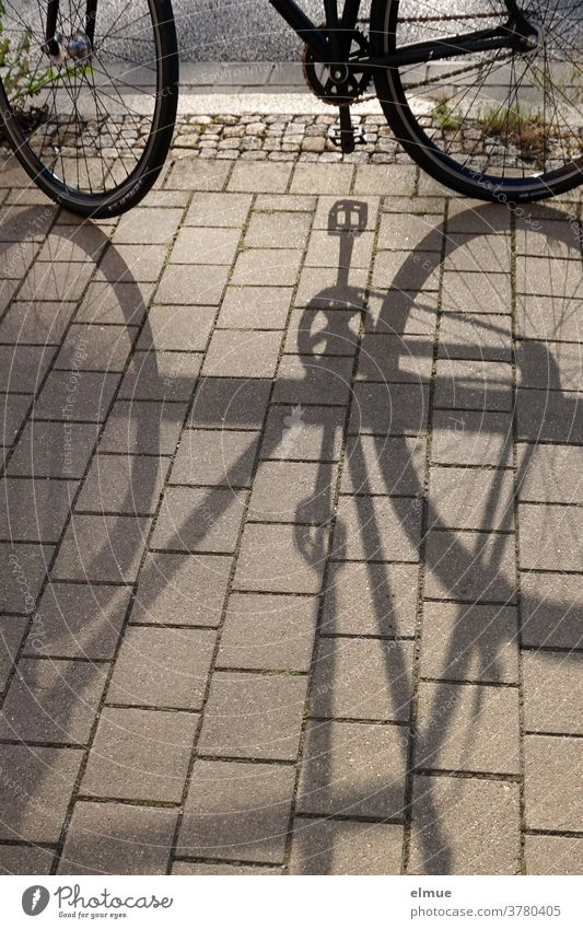 While the shade of his parked bicycle grew longer and longer, the time until the beer garden bar was closed was steadily decreasing ... Bicycle Shadow