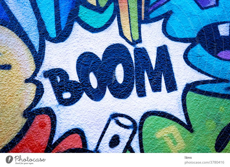 BOOM l Explosion boom Graffiti House (Residential Structure) built Wall (building) Facade Exterior shot Characters Deserted Wall (barrier) Town Colour photo