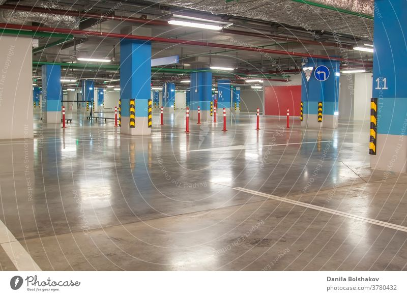 Empty parking garage underground interior in apartment or in supermarket architectural architecture area basement building car cement city column concrete