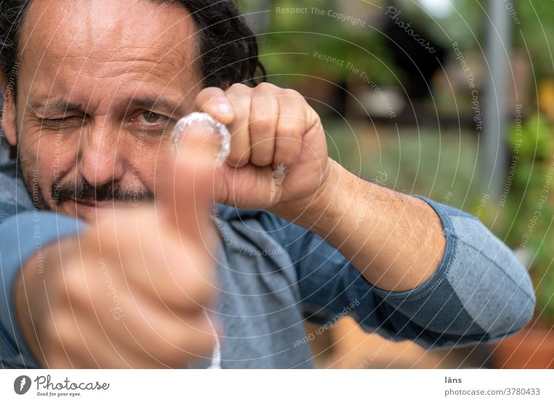 point and shoot Man Aim Human being Target fun game Looking into the camera Forward wink Colour photo