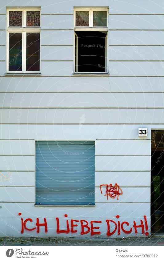 33 I LOVE YOU! House number Facade Building Wall (building) Window Graffiti Day Characters Daub Damage to property Colour Red embassy Love I love you Street