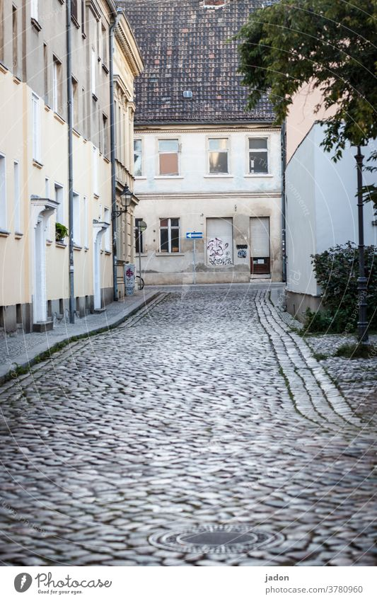 empty streets (30). Street Cobbled pathway Paving stone Exterior shot Deserted Day Lanes & trails Town Gray Traffic infrastructure Colour photo Sidewalk