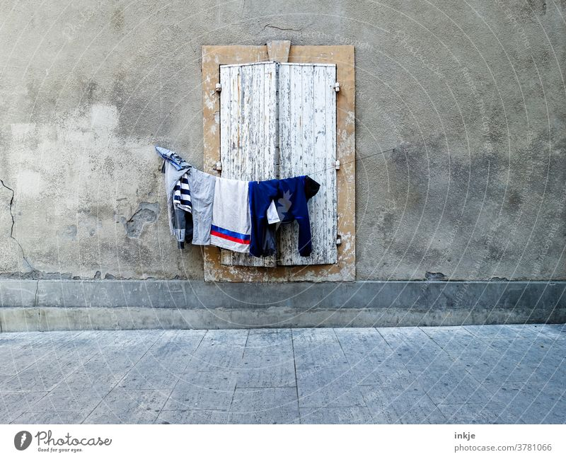 hung clothesline in front of closed window Facade Deserted Closed Laundry Colour photo out House (Residential Structure) Wall (building) Gloomy arm Shutter