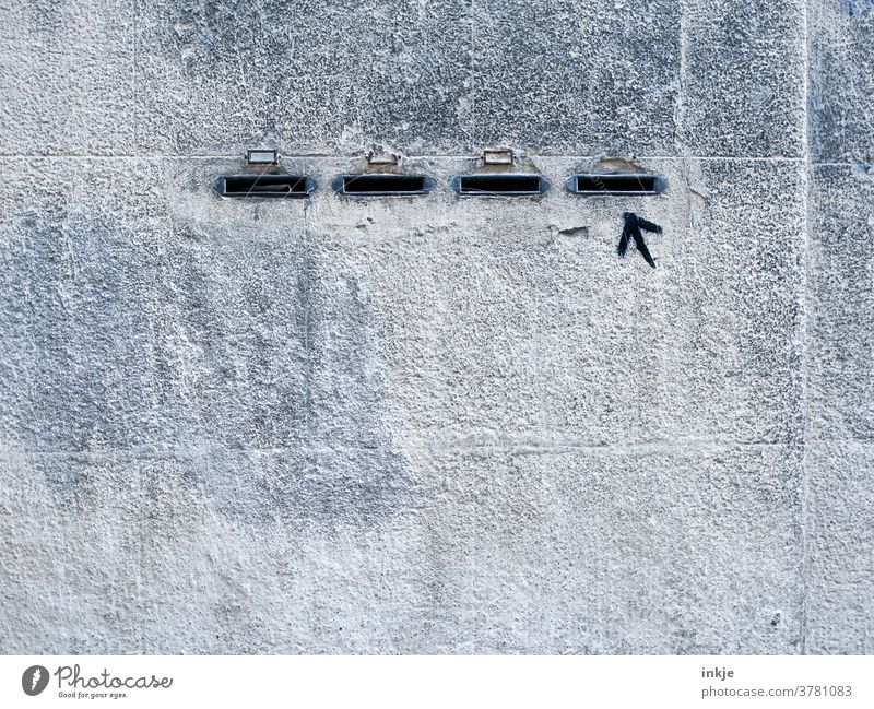 Voters of the right Wall (building) Facade Colour photo Gray Gloomy Copy Space Slit four Arrow Clue Exterior shot Wall (barrier) Deserted Building Right
