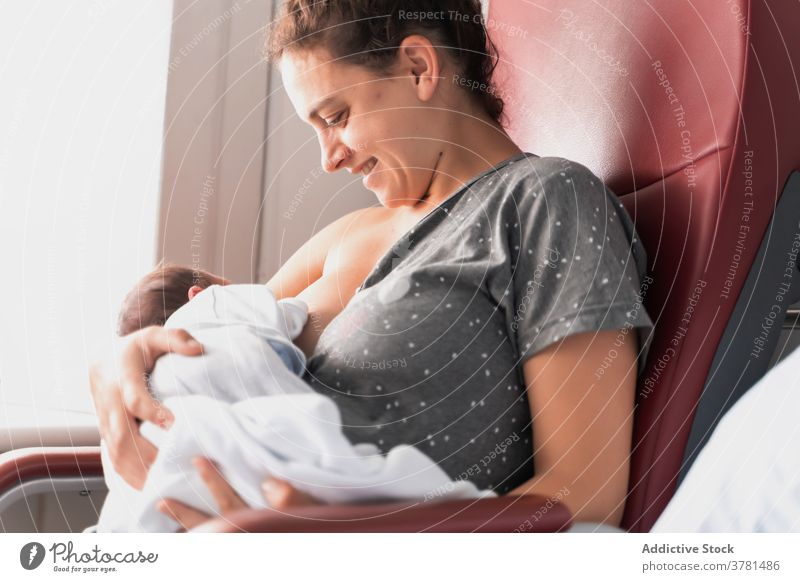 Happy mother breastfeeding newborn baby love motherhood maternal relationship life happy child childcare kid childhood mom infant nurse ward bonding tender