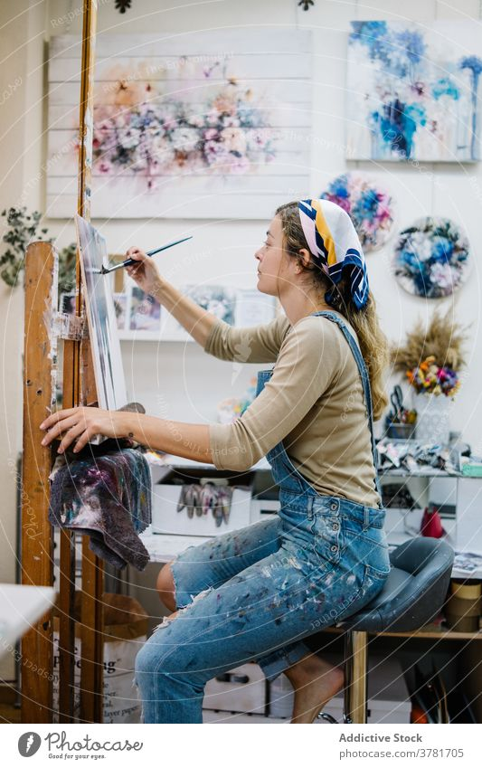 Female artist painting on canvas in workshop woman easel creative draw talent female colorful picture hobby craft inspiration artwork occupation skill