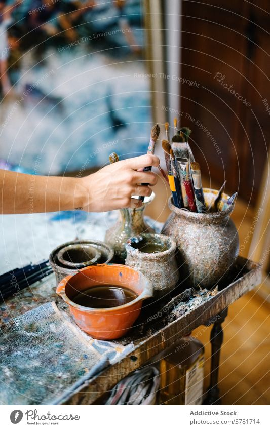 Creative craftswoman painting picture in workshop artist paintbrush creative canvas draw talent female tool hobby inspiration artwork occupation skill