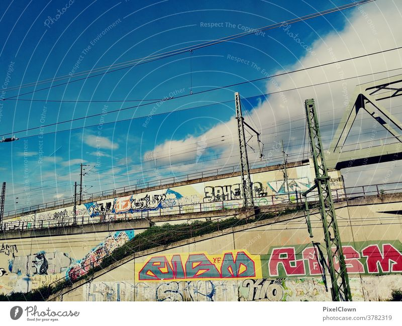 Graffiti at the station Train station Railroad Vacation & Travel Transport Railroad tracks Wall (building) street art Sky electricity urban City Rail transport