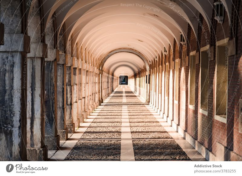 Arched passage with stone columns in city arched gallery archway walkway architecture aged sunlight historic exterior building amazing old facade ancient