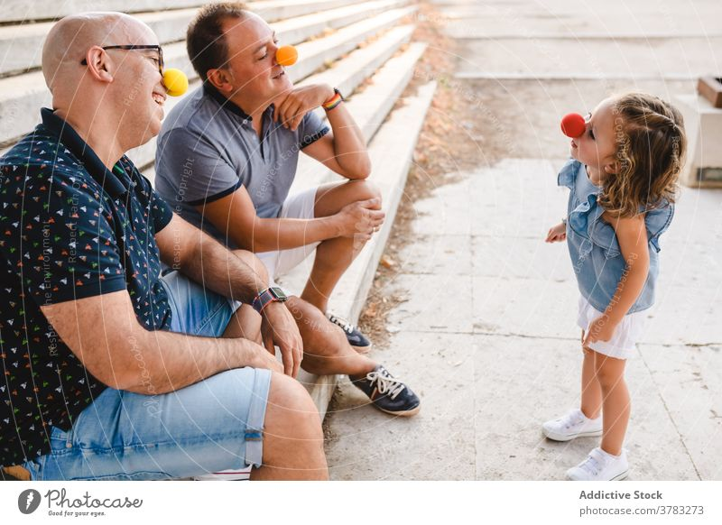 Gay couple with kid having fun lgbt family gay parent play homosexual cheerful child adopt daughter dad father together relationship love happy bonding