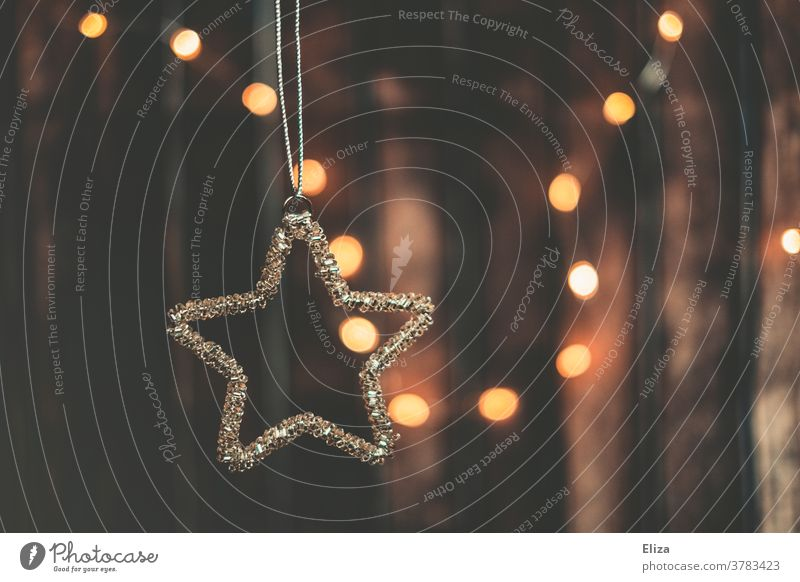 Christmas decorations. Star as Christmas tree decoration and lights in the background. Christmas tree decorations Stars Trailer Fairy lights Christmas & Advent