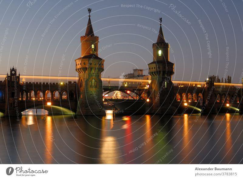 illuminated oberbaum bridge in berlin over the spree river Night Landmark Illuminated Germany Oberbaumbrücke River urban travel Transport Spree famous Scene