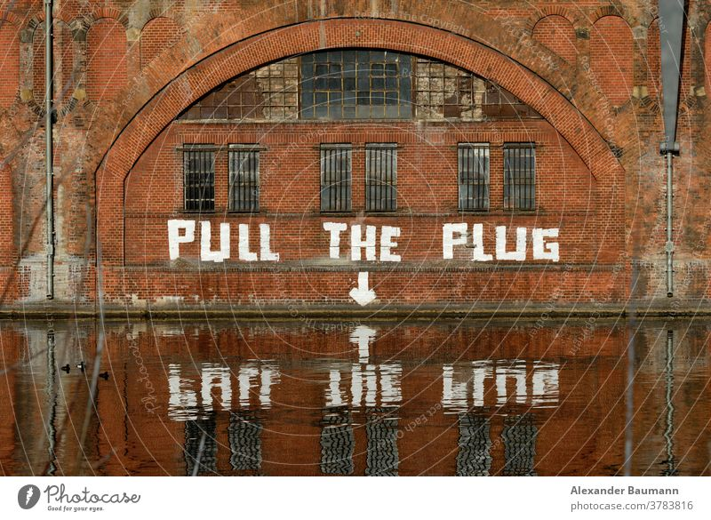 graffiti art on a brick wall water reflections mirror beautiful culture travel destinations architecture funny suburban berlin