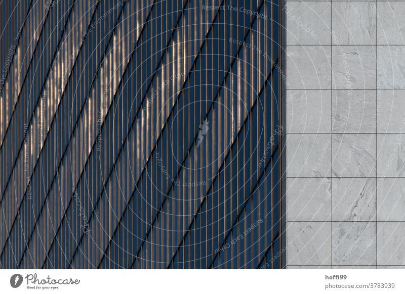 the setting sun is subtly reflected in the facade of the high-rise Abstract Glass Facade Financial Industry Architecture Building High-rise Design Reflection